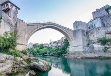 (Titelbild) Stari Most über dem Fluss Neretva. photo credit: Faruk Kaymak via unsplash